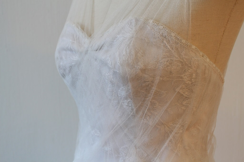 Lunar lace and soft tulle wedding dress side detail